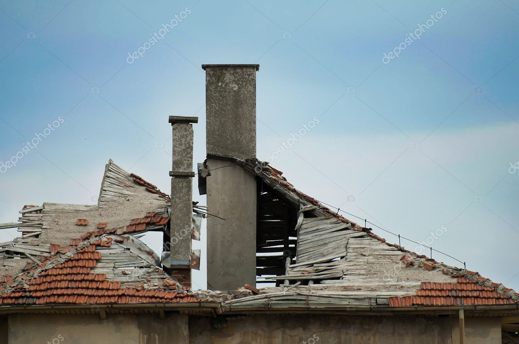 Old building with destroyed tiled roof.  Stock Photo #7002909
