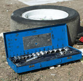 Car mechanic tools and tire — Stock Photo