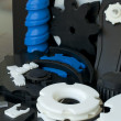 Stock Photo: Plastic machine parts. Vertical imagel