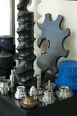 Plastic and metal machine parts. Vertical imagel — Stock Photo