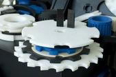 Plastic machine parts. Vertical imagel — Stock Photo