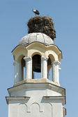 Stork in nest on dome of a church — Stock Photo