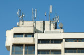 GSM transmitters on a roof — Stock Photo