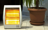 Electric heater and Pot — Stockfoto