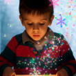 Stockfoto: Child peeping in a gift box