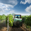 Tractor spraying vineyards with chemicals — Stock Photo #7531648