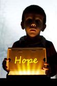 Child and box shine light — Stock Photo