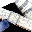 Stock Photo: Moleskin, scale ruler, and hundred dollar bills