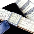 Moleskin, scale ruler, and hundred dollar bills — Stock Photo