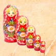 Babushka doll family on marble — Stock Photo