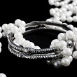 Silver bracelets and pearls — Stock Photo #7650674