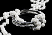 Silver bracelets and pearls — Stock Photo