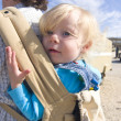 Stock Photo: Cute toddler in baby carrier