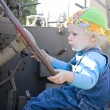 Baby girl driving an armor vehicle — Stock Photo