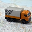 Stock Photo: Concept small white toy car on italy map
