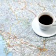Cup of coffee on the map. concept — Stock Photo