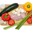 Chicken, knife and vegetables on a cutting board, isolated on white — Stock Photo