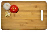 Garlic and tomato on a cutting board, isolated on white — Stok fotoğraf