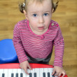 Little girl playing the piano - Photo