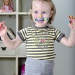 Little girl and colored paints — Stock Photo