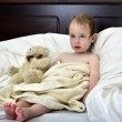 Little girl in a towel after a shower resting on a bed — Stock Photo #7394923