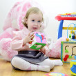 Little girl in a room with toys — Stock Photo
