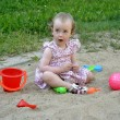 Little girl playing in the sandbox — Stock Photo
