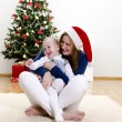 Little girl and her mom having fun at Christmas — Stock Photo
