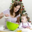 Royalty-Free Stock Photo: Little girl and mother are preparing Christmas cookies