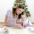 Little girl and mother are preparing Christmas cookies — Stock Photo