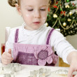 Stock Photo: Little cute girl making Christmas cookies