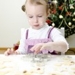 Little cute girl making Christmas cookies — Stock Photo