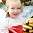 Little girl holding christmas gift — Stock Photo