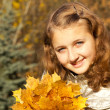 Teen girl in autumn park - Stock Photo