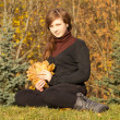 Teen girl in autumn park — Stock Photo