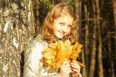 Teen girl in autumn park — Stock Photo