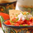 Spicy salsa with tortilla chips — Stock Photo #6777927