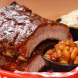 Stock Photo: BBQ Ribs with beans and cole slaw