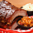BBQ Ribs with beans and cole slaw - Stock Photo