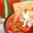 Spicy salsa with variety of ingredients - Stock Photo