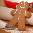 Making delicious gingerbread men - Stock Photo