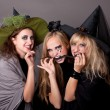 Three witches eat  black snake — Stock Photo