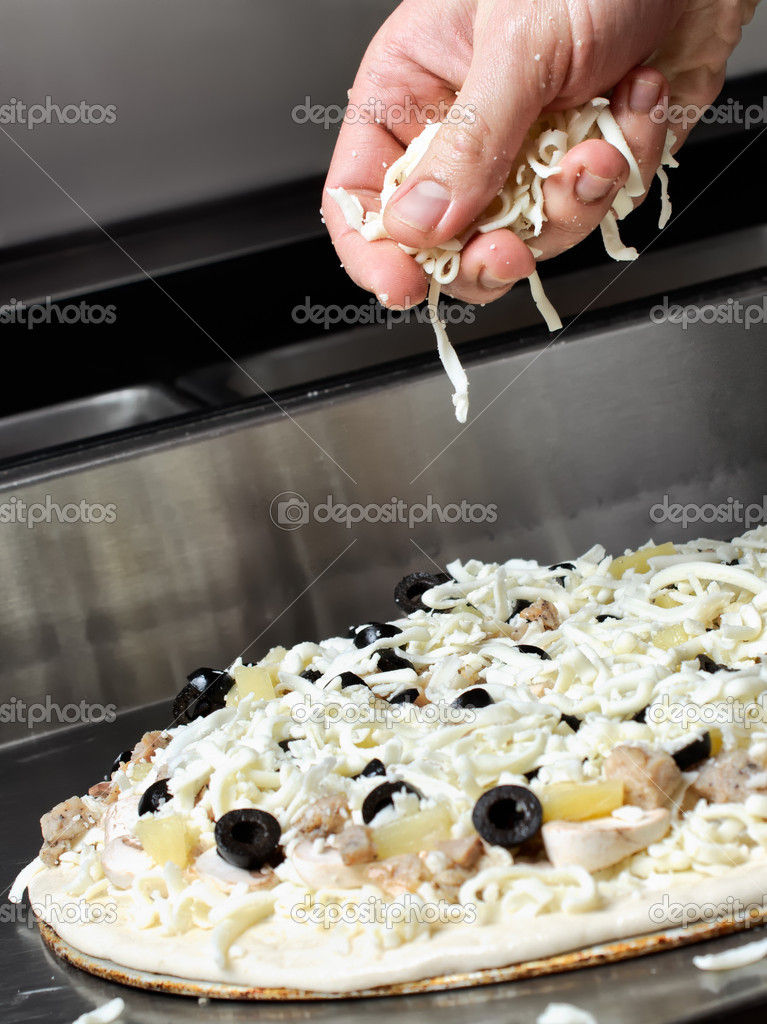 Making an Italian style pizza at kitchen — Stock Photo #7183916