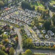 Aerial View of Bright Suburban Neighborhood - Stock Photo