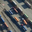 Freight Trucks in Trainyard - Aerial - Stock Photo