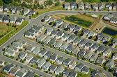 Houses along suburban roads — Stock Photo