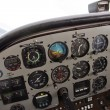Pilot View of Complex Instrument Panel of Airplane - Stock Photo