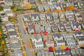 Sunshine on Small Suburban Development — Stock Photo