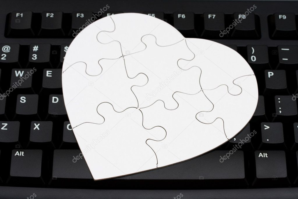 Computer keyboard with a heart shaped puzzle in it, Internet Dating — Stock Photo #7235366
