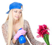 Young blonde woman with gardening — Stock Photo